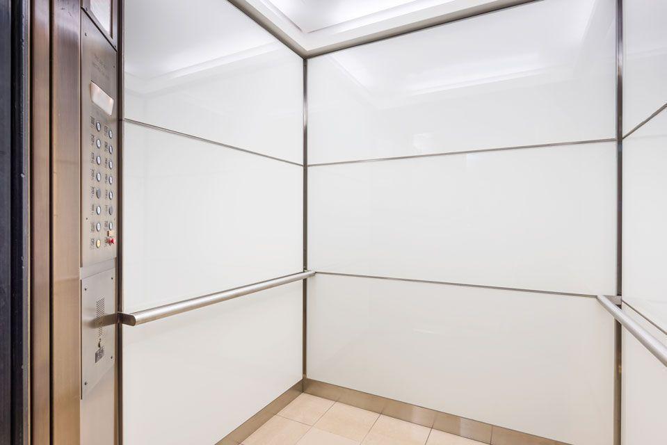 Elevator cab interiors custom standard designs Elevator cabin design